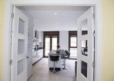 Salón comedor con puertas apertura 180 grados
